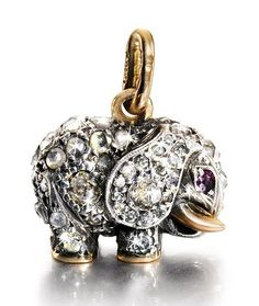 A Fabergé jewelled gold pendant, workmaster August Holmström, St Petersburg, circa 1900, modelled as an elephant, the surface set with rose-and circular-cut diamonds, ruby eyes and gold tusks