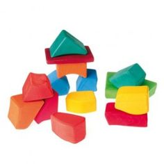 Colored Waldorf Wooden Blocks from Grimms Spiel & Holz. 15 brightly colored blocks come in a cotton net bag. The organic shapes are easy for young children to grasp.