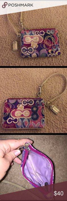 Authentic coach bling wristlet ! Pink, purple and blue bling coach wristlet ! No sequins missing. No defects with zipper. Great condition! Only flaw is a light stain on the inside of the wristlet as pictured. But who's looking on the inside with such a cute outside?! Accepting offers Coach Bags Clutches & Wristlets