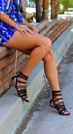 Black strapped flat sandals. Latest shoes trends.