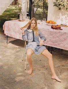 Going barefoot, Anna Ewers models Coch 1941 dress and Miu Miu sunglasses