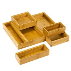 Stackable Bamboo Drawer Organizers  This is great for organizing small items, gadgets or stationary