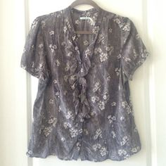 Black and white floral blouse Adorable floral button up blouse with ruffle down the front. Kimchi Blue Tops Button Down Shirts