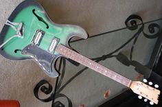 1960s Japanese Mosrite-inspired semi-hollowbody  From http://guitarz.blogspot.com #2 - Love the shape/color!