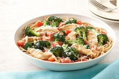 Chicken and broccoli are served on a bed of whole-wheat pasta in this weeknight-easy dish for two. Sprinkle with Parmesan and prepare for compliments.