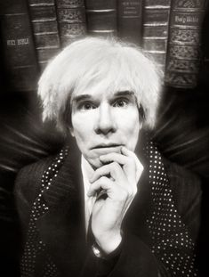 Andy Warhol, Last Sitting (1986) photo by David LaChapelle The above photograph is the last portrait of Warhol before he died. Notice the volumes of the Holy Bible in the background.