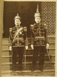 Emperor Gojong, left, and Crown Prince Sunjong of the Korean Empire, pose together in this photo taken circa 1905. / Courtesy of Cornell University Library