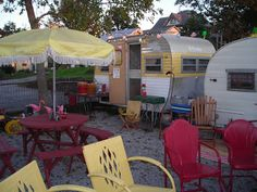 LOVE these vintage metal motel chairs~ for my HOME patio! Make an umbrella like this?