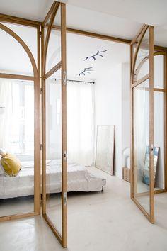 wood and glass doors inside parisian art gallery concept store. / sfgirlbybay