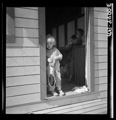 8. 1935 is when this child was in preschool. His family members were immigrant farm workers and he was being watched inside while they worked.
