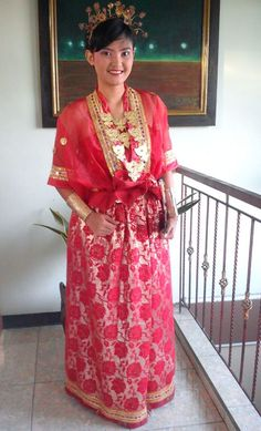 Baju Bodo is traditional cloth for Bugis women in Sulawesi , Indonesia . Baju Bodo's shape is rectangle , normally has short sleeves (never cover the elbow) .  According to Bugis culture , every colour of Baju Bodo that worn by Bugis women will show the ages or status of the owner . For example : red is for 17-25 year old girls , white is for maids , green is for high class girls , etc . Normally it's worn for wedding party .  Vania Kartika Chandra FD1A2 Task 1
