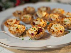 Toasted Gruyere and Cranberry Cups - Get Toasted Gruyere and Cranberry Cups Recipe from Food Network Source by lisakpetersen Tostadas, Easy Holiday Recipes, Thanksgiving Recipes, Quick Recipes, Simple Recipes, Christmas Recipes, Christmas Main Dishes, Thanksgiving Lunch, Holiday Meals