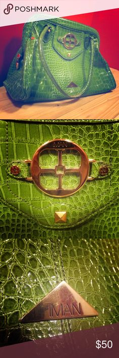 Iman green aligator skin purse High end good quality purse! Small flaw on the front (as pictured) hardly noticeable since the bag is rather large! Only asking 50.00 for it because of the flaw! Offers are welcome! IMAN Bags Shoulder Bags
