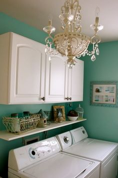 There is no reason why a laundry room can't be fabulous…and Tiffany blue with a glam chandelier!