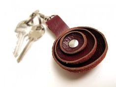DIY Leather Key Chain This would be really cute in bright colored leather, to look like a flower.