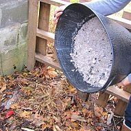 There are many more uses for fireplace ashes than I ever knew. 1. Compost bin - only a little amongst the organic matter. 2. A light layer around plants can keep slugs away. 3. A tablespoon of ash to 1000 gallons of water for a pond will keep algae down.. 4. As a fertilizer. 5. Cleaning silver.  good use of ashes from firepit