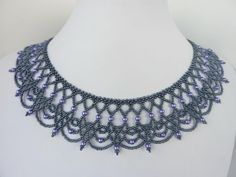 DIY Jewelry: FREE beading pattern for an elegant beaded lace necklace made from 11/0 seed beads and 4mm pearls. An ornate yet graceful design with old-world style.