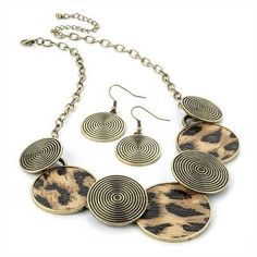 Burnished-gold-effect-disc-necklace-and-earring-set-with-animal-print from Picsity.com