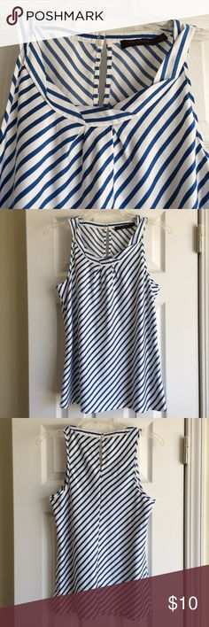 The Limited Diagonal Stripe Top Diagonal bright blue & white stripes. Keyhole opening on back with a button. Excellent used condition. 100% polyester The Limited Tops Blouses