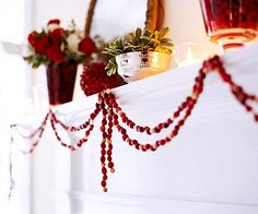 Simple Cranberry Garland  String fresh berries into a simple garland using a needle and monofilament line. Intersperse wooden beads for variation in texture and to stretch your supply of fresh cranberries. Drape the garland into loose swags from small nails or hooks in the mantel.