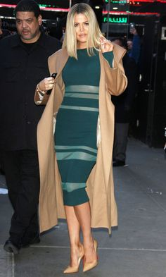 Khloe Kardashian in a green sheer-striped midi dress, camel coat and nude heels - click ahead for more winter outfit ideas