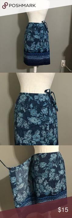 Coldwater Creek Blue Print Faux Wrap Skirt Size 16 Blue print faux wrap skirt with elastic across the back of the waist band. Skirt has a button on one side of the waist band and a clasp and tie at the other. Made of 100% polyester. Skirt length is 22 inches and across the waist is 15 inches but will stretch out 3-4 inches. Coldwater Creek Skirts