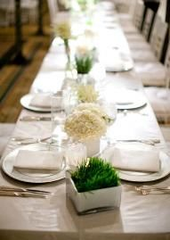my favorite - low centerpieces, white/cream flowers alternating with potted grass