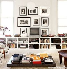 hide the tv by surrounding it with framed pictures...