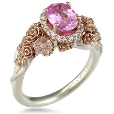 Floral Bouquet Engagement Ring - Wear a bouquet of flowers on your ring finger! The main example shown has rose gold flowers and green gold leaves. Paved diamonds encircle the center stone. Ideal cut accent diamonds. Inquire for pricing on two-tone.