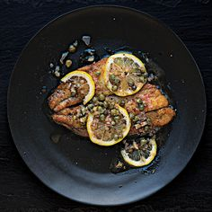 Flaky white fish is pan-fried and finished with a white-wine butter sauce laced with lemon, capers, and shallots.