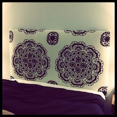 DIY headboard made out of an anthropologie tablecloth. I like it!