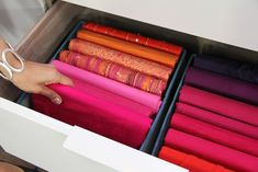 wrap scarves around pieces of cardboard for a neat and organized effect