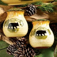 """Black Bear Forest Salt & Pepper Set by Black Forest Decor. $19.95. Hand-painted black bear scenes and scalloped edges make the terracotta ceramic Black Bear Forest Salt & Pepper Set a welcoming touch in your kitchen. Dishwasher, oven and microwave safe. Measures 3"""" Dia. x 3??""""H each. ~"""