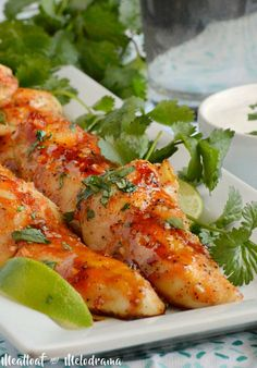 These sweet and spicy Baked Honey Sriracha Chicken Tenders make a delicious quick and easy dinner or a yummy appetizer anytime!
