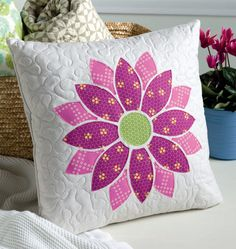 This Bloom Pillow designed by Andy Knowlton relies on fusible applique and a straight stitch around raw edges - construction's as easy as smelling spring flowers. It's another bloomin' beautiful project from the new book Sew Many Gifts!