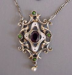 Below Pendant with white enamel, pearl drop, purple and green stones