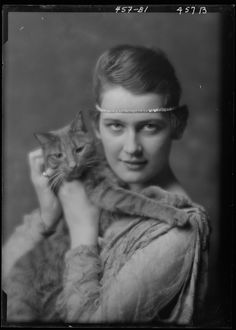 Early 1900s portrait studio used cuddly cat as adorable prop