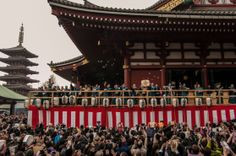 """Setsubun also means mamemaki or """"bean throwing"""": members of the Sensoji association in kamishimo samurai clothing and Asakusa celebrities throw baked soy beans to the crowds to exorcize the oni ogres of misfortune. And when oni are out, good fortune is in. Taken on February 3, 2014. © Grigoris A. Miliaresis"""