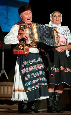Most of villages in region Podpoľanie (Central Slovakia) use embroideried male aprons worn exclusively by men which could, or couldn't be part of costume. Their difference from female aprons is that they are more narrow and composition of ornaments is in horizontal lines and doesn't cover hem.