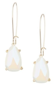 """Small faceted stones swing from the end of slender drop earrings versatile enough for every occasion.  2 1/8"""" drop; 1/2"""" width. Earwire with hook closure. 14k-gold plate/magnesite or glass. By Kendra Scott; imported."""