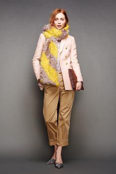 Khaki boyfriend pants worn with a pink blazer and a furry striped scarf for the J.Crew Fall/Winter 2015 Presentation