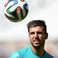 Portugal's midfielder Miguel Veloso eyes the ball at Jamor stadium in Oeiras