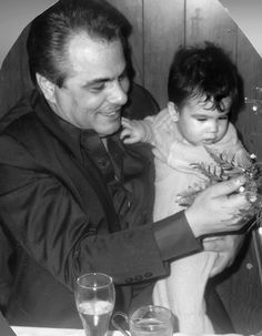 John Gotti holds son, Frankie. The boy was fatally mowed down on his bike at the age of 12 by a driver on March 18, 1980. The driver, a neighbor of the famiy, vanished months later.