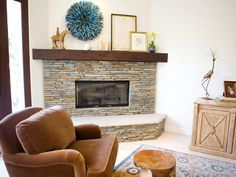 Eclectic Charm    Eclectic art pieces rest atop the mantel of this stacked stone fireplace. A heavy wood beam functions as natural artwork, and the ledge of the hearth provides extra seating for cold winter nights.