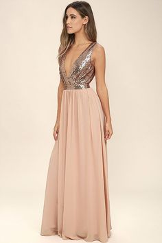 The Elegant Encounter Rose Gold Sequin Maxi Dress was made for fairy tale endings! A sleeveless sequin bodice with no-slip strips, and plunging V-neckline, is met by a fitted waist, and full woven maxi skirt. Hidden back zipper/clasp.