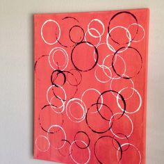 DIY: abstract wall paintings. Paint a canvas any color of your choosing. Dip plastic cups, rim side down in accent paint colors and press against the canvas.