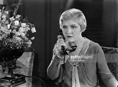 1926: Laura La Plante makes a telephone call in a scene from the film 'Butterflies in the Rain'.
