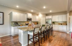 Kitchen with seating space in the Magnolia home.