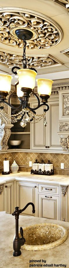Stunning medallion/ceiling feature and chandelier in kitchen