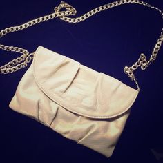 Beige bag Beige snake skin bag with gold chain. A little pink lipstick stain inside shown in picture Bags
